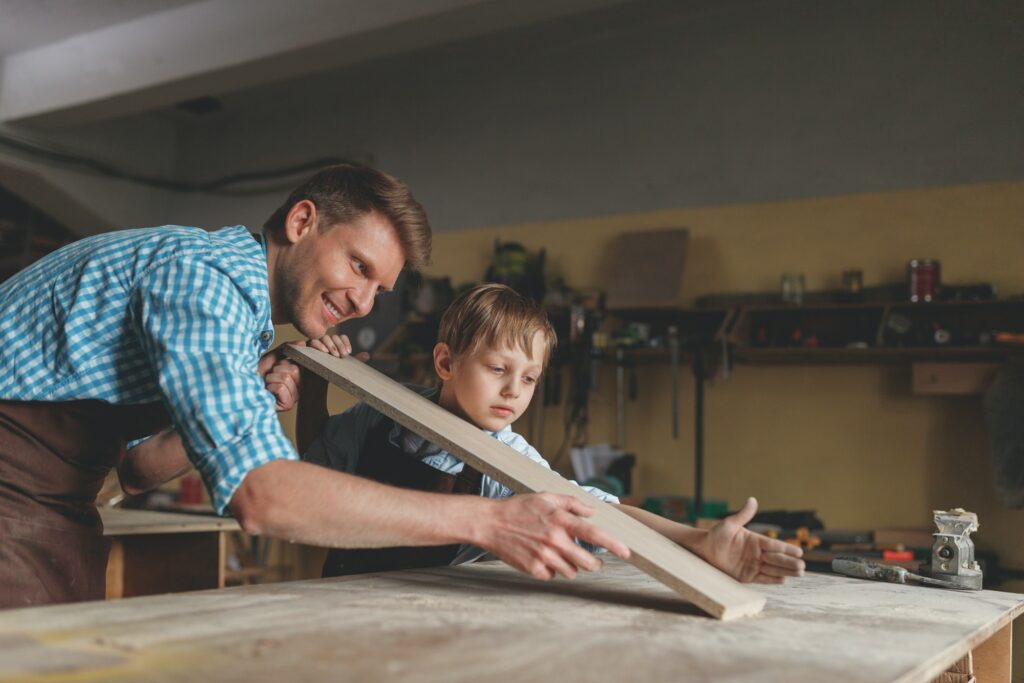 Dad and Son at Working in the Shop