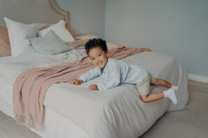 Happy little afro american kid enjoying playtime at home