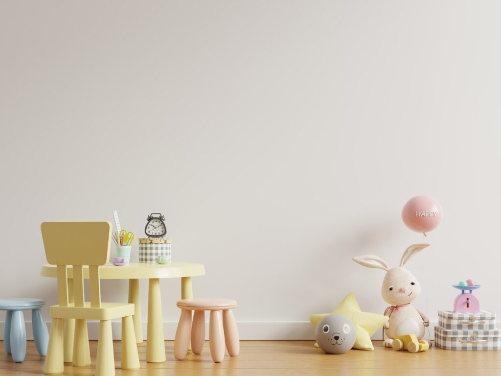 Mock up wall in the children's room with kid table set in light white color wall background.